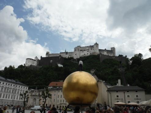 Man on a golden sphere on the Kapitelplatz