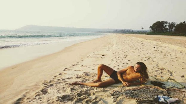 the mindful blogger on the beach in the tropics