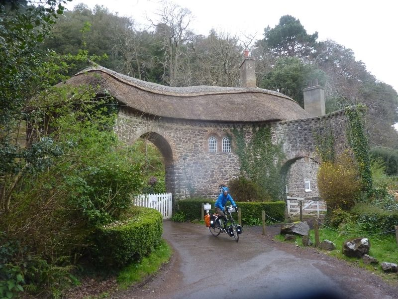 passing a thatched cottage cycling in devon