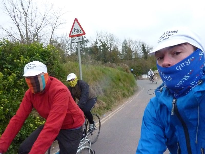 three masked riders on bicycles in devon